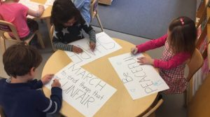 "Students created protest signs using the ""big words"" they learned."