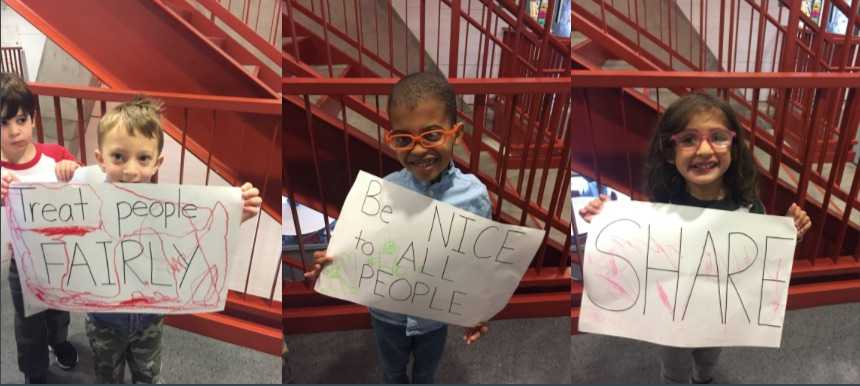 "Students in the EC created signs with the ""big words"" they learned including ""treat people fairly,"" ""be nice to all people,"" and ""share."" They then peacefully marched around the halls of Gaynor."